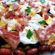 Huevos rotos con chistorra y jamón